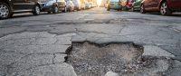 Risarcimento danni per buche stradali:chi paga e come richiedere il rimborso